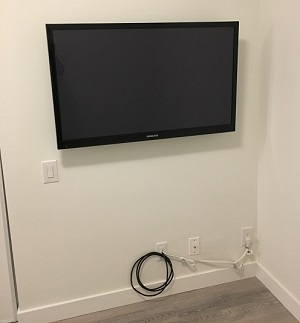 TV Display mounted on wall hidden wires